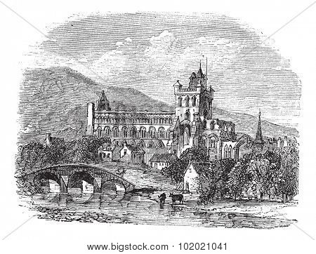 Jedburgh Abbey in Scotland, during the 1890s, vintage engraving. Old engraved illustration of Jedburgh Abbey with lake and bridge in front.  Trousset encyclopedia (1886 - 1891).
