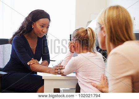 Mother And Daughter Visiting Doctor In Surgery
