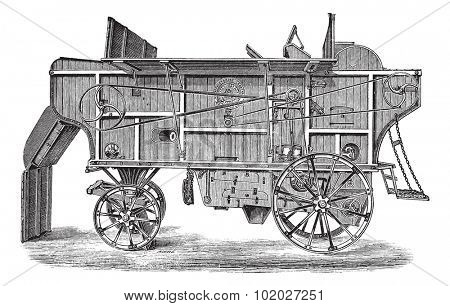 Old engraved illustration of thresher machine (Hornsby). Industrial encyclopedia E.-O. Lami - 1875.