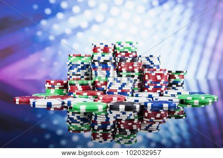 Poker Chips on a gaming concept poster