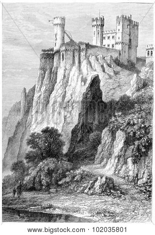 Rheinstein Castle in Rhineland-Palatinate, Germany, shown above the banks of the Rhine River, vintage engraved illustration. Magasin Pittoresque - 1867