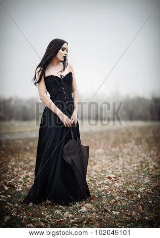 Beautiful Sad Goth Girl Holds Black Umbrella