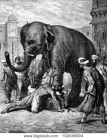 The punishment of a traitor. The elephant crushes his head with a single blow, vintage engraved illustration. Journal des Voyage, Travel Journal, (1880-81).