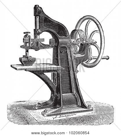 Mechanical grinding of the wheel to the colors, vintage engraved illustration. Industrial encyclopedia E.-O. Lami - 1875.