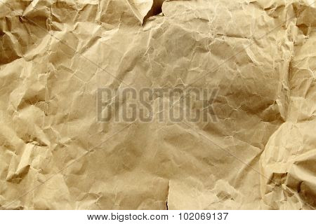 Closeup of brown wrinkled paper texture background poster