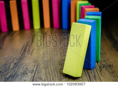 The domino effect of colorful wooden blocks