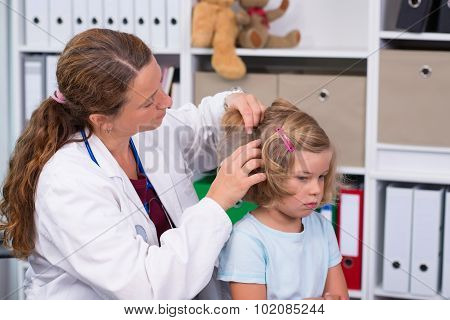 Female Pediatrician In White Lab Coat Examined Little Patient