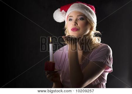 Santa Claus In Dark With Candle