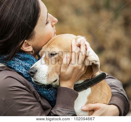 Woman With Her Dog Tender Hugs . poster