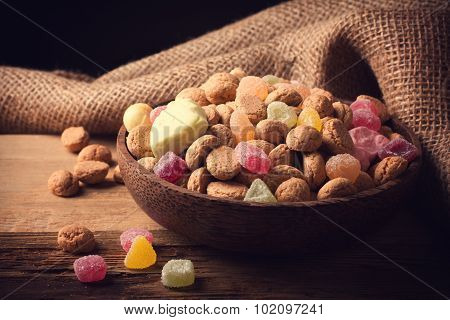 Wooden bowl with typical dutch sweets for Sinterklaas