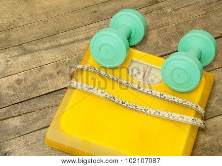 Dumbbells And Weight Scale Machines