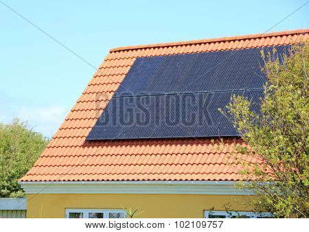 Solar Panel On House Roof With Red Tiles