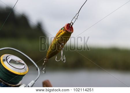 Plastic fishing lure wobbler on the spinning