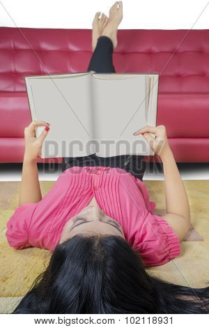 Clever Student Reading Book On The Carpet
