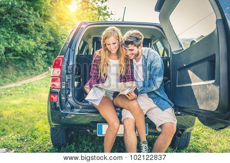Couple On Off Road Car Looking At The Map