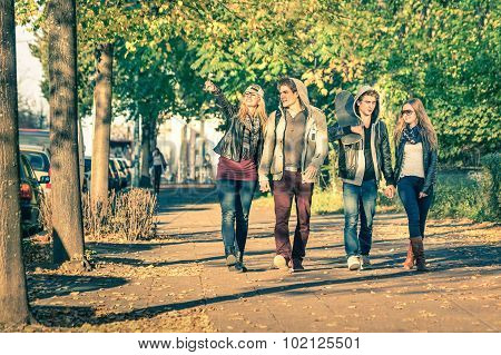 Group Of Happy Best Friends With Alternative Fashion Look Walking At The Park - Hipster Tourists
