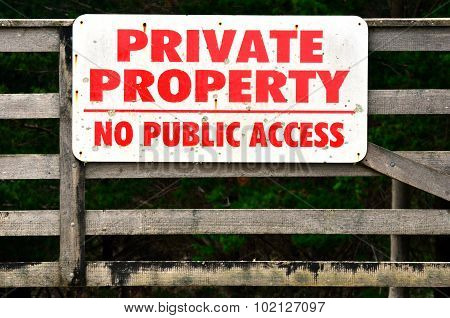Sign on a farm gate reading Private Property - No Public Access