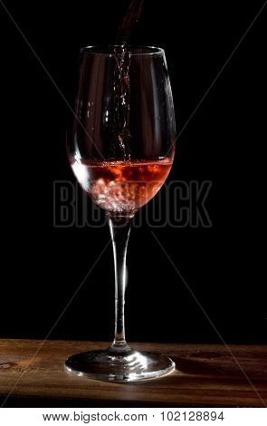 Pouring Rose Wine