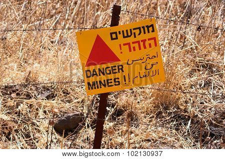 Danger mines - old sign warning of land mines or minefield in the Golan Heights Israel.