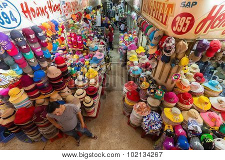 HO CHI MINH VILLE, VIETNAM, FEBRUARY 26, 2015 : Hat department in the old traditional market of Cho Binh Tay in the Chinatown district of Ho Chi Minh Ville, (Saigon), Vietnam.