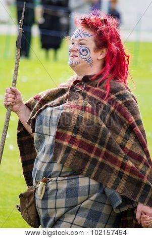 FORT GEORGE, SCOTLAND - AUGUST 8: Unidentified actor in Pictish costume at Fort George, Scotland, 8 August 2015