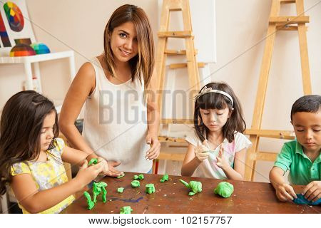 Teacher And Students During Art Class