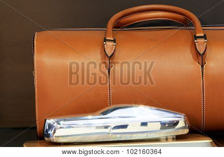 Mini Model Of Royce Luxury Car And Brown Leather Bag With Logo Rr