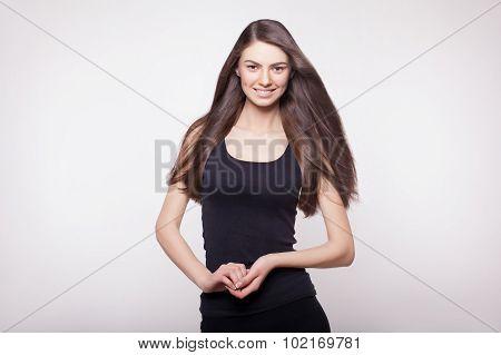 Snapshot Of Smiling Long Hair Model In Studio