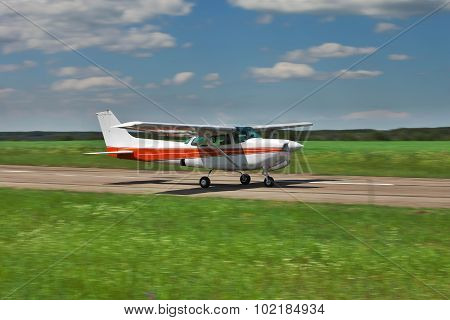Private plane taking off from a small airfield poster