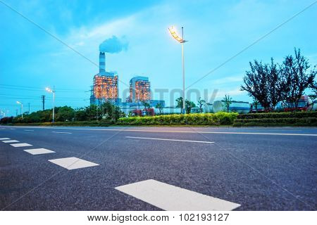 high way road near a powerplant