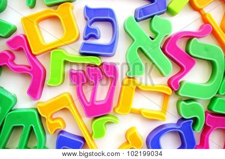 The Hebrew alphabet letters on a fridge which help children to spell.