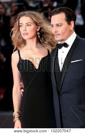 Johnny Depp, Amber Heard at the premiere of Black Mess at the 2015 Venice Film Festival. September 4, 2015  Venice, Italy