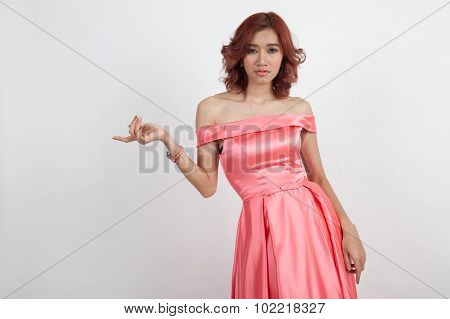 Half Portrait Of A Beautiful Girl In A Red Dress Isolated On Overwhite Background;upturned Hand