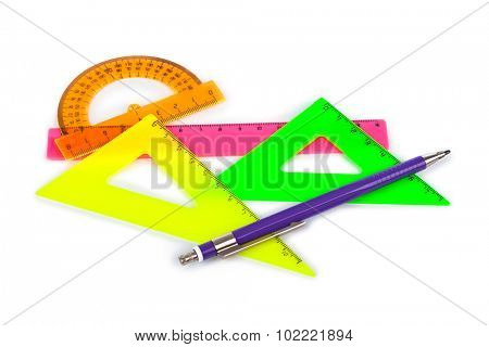 Multicolored rulers and pencil isolated on white background