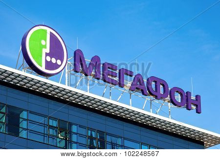 Logo Of Megafon Against Blue Sky