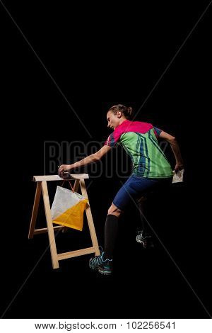 Woman punching at control point participating in orienteering competitions
