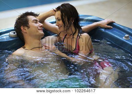 Couple bathing at jacuzzi