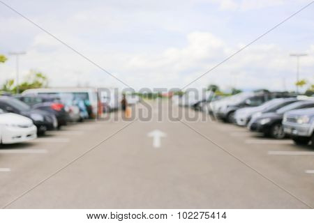 Abstract Blurred Car In Outdoor Parking Lot At Daytime