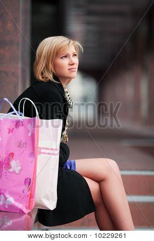 Sad Young Shopper.