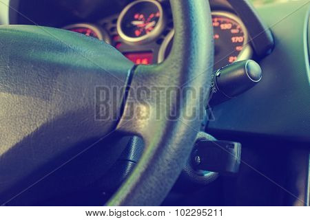 Key inserted into the lock of ignition of the car