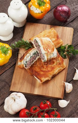 Turkish borek with burger patty wrapped in phyllo pastry poster