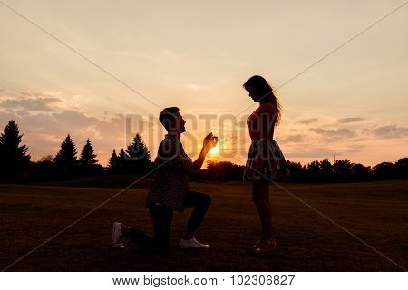 Silhouette Of A Man Makes A Proposal Of Betrothal To His Girlfriend