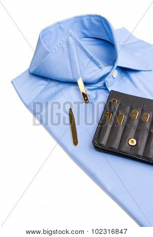 Folded shirt with gold collar stays