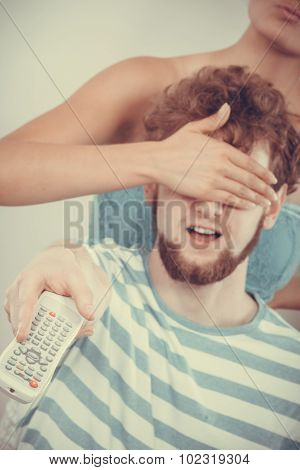 Funny Couple On Sofa With Tv Remote