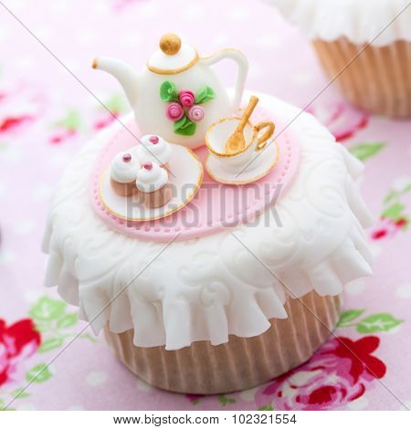 Cupcake decorated with mini sugarpaste tea party