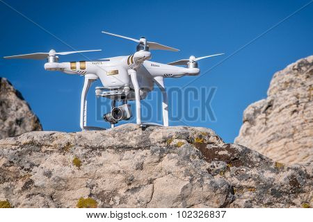 CARR, CO, USA, SEPTEMBER 20, 2015:  Radio controlled Phantom 3 quadcopter drone on a sandstone cliff ready to take off for aerial photography mission.