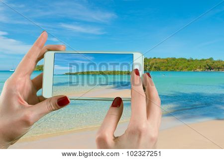 Summer, Travel, Vacation And Holiday Concept - Back View Of A Woman Taking Photograph With A Smart P