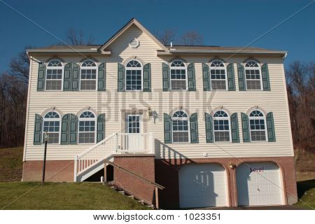 new two story colonial home with shutters and two car garage - sold. poster