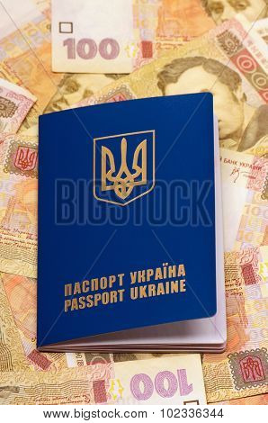 International Ukrainian passport on Hryvna banknotes background