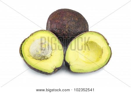 Stack of sliced Hass avocados isolated on white.